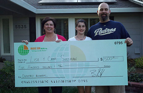 Residential family receiving money for solar panel referral.